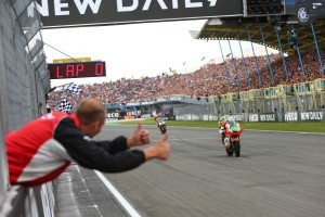 West crosses the checkered flag in first position